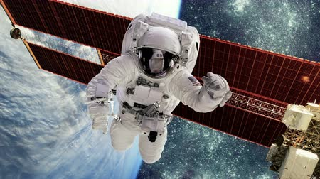 gravidade : Astronaut in outer space against the backdrop of the planet earth.