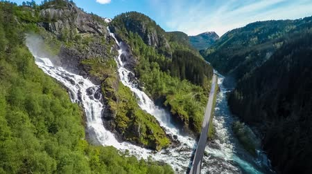 foss : Aerial footage Latefossen Waterfall Odda Norway. Latefoss is a powerful, twin waterfall. View from the birds-eye view.