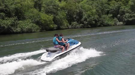 pwc : Couple on jet ski. Water scooter