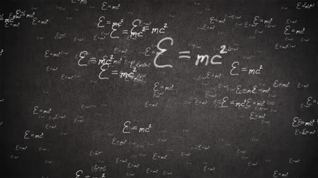 the conception : Flight Einstein formula on a black background Stock Footage