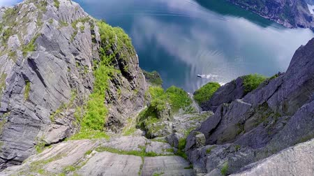 pulpit rock : Preikestolen or Prekestolen, also known by the English translations of Preachers Pulpit or Pulpit Rock, is a famous tourist attraction in Forsand, Ryfylke, Norway