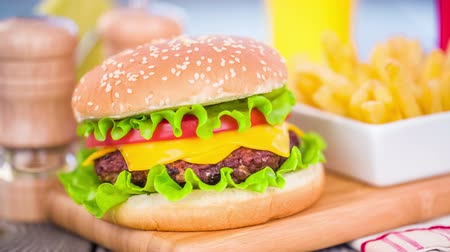 gourmet : Tasty and appetizing hamburger cheeseburger Stock Footage
