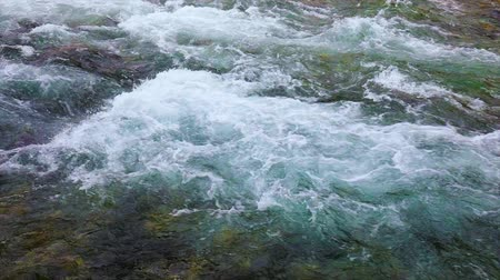 limpid : Mountain river water with slow motion closeup