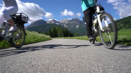 treadle : Couple woman and man on electric eco bike cycling Italy Dolomites Alps
