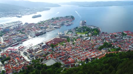 small height : Bergen is a city and municipality in Hordaland on the west coast of Norway. Bergen is the second-largest city in Norway. The view from the height of the bird flight. Aerial FPV drone flights.