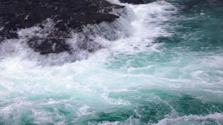 limpid : Mountain river water with slow motion closeup. Norway Beautiful Nature.