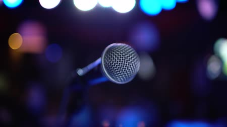 protrude : Microphone on stage against a background of auditorium