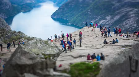 pulpit rock : NORWAY- June 22, 2015: Preikestolen or Prekestolen, also known by the English translations of Preachers Pulpit or Pulpit Rock, is a famous tourist attraction in Forsand, Ryfylke, Norway Stock Footage