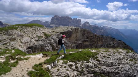 tre : Hiker woman standing up. National Nature Park Tre Cime In the Dolomites Alps. Beautiful nature of Italy. Stock Footage