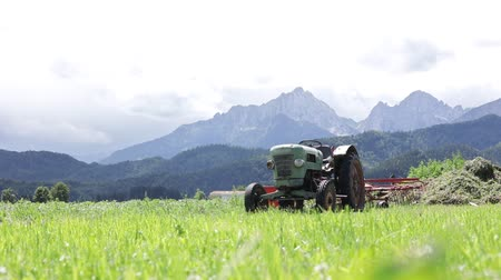 sow : Old tractor in the Alpine meadows