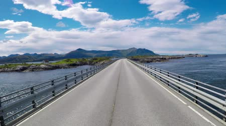 eyaletler arası : Driving a Car on a Road in Norway The Atlantic Ocean Road or the Atlantic Road (Atlanterhavsveien) was awarded the title as (Norwegian Construction of the Century).