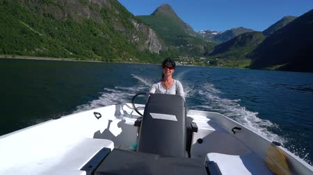 Woman driving a motor boat. Geiranger fjord, Beautiful Nature Norway.Summer vacation. Dostupné videozáznamy