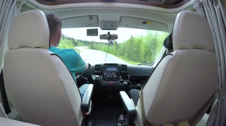 Man driving on a road in the Camper Van RV. Caravan car Vacation. Family vacation travel, holiday trip in motorhome Dostupné videozáznamy