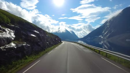 államközi : Driving a Car on a Road in Norway