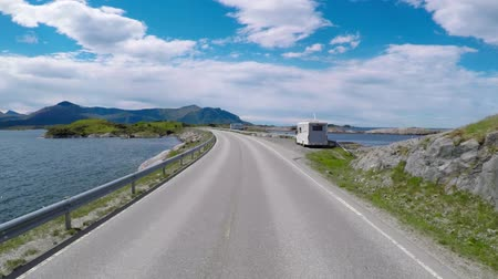 realtime : Driving a Car on a Road in Norway The Atlantic Ocean Road or the Atlantic Road (Atlanterhavsveien) was awarded the title as (Norwegian Construction of the Century).