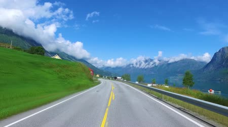 norvégia : Driving a Car on a Road in Norway