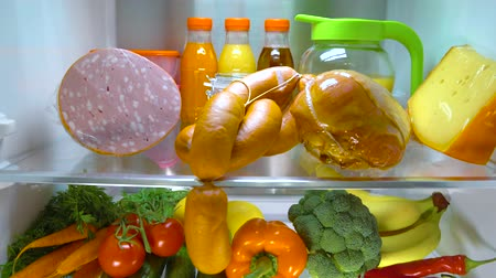 капуста : Open refrigerator filled with food.