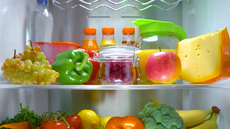 lodówka : Open refrigerator filled with food. Healthy food. Wideo