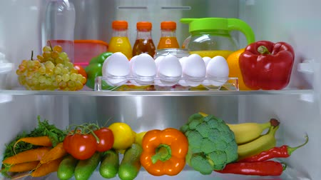 produtos lácteos : Open refrigerator filled with food. Healthy food. Vídeos