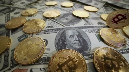 fizetés : Gold Bit Coin BTC coins and dollar bills. Bitcoin is a worldwide cryptocurrency and digital payment system called the first decentralized digital currency.
