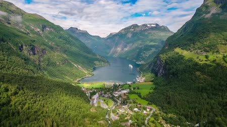 treyler : Geiranger fjord, Beautiful Nature Norway. It is a 15-kilometer (9.3 mi) long branch off of the Sunnylvsfjorden, which is a branch off of the Storfjorden (Great Fjord). Stok Video