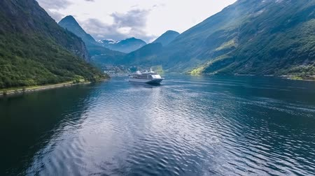 caravan : Geiranger fjord, Beautiful Nature Norway. Aerial view of the campsite to relax. Family vacation travel, holiday trip in motorhome RV. Stock Footage