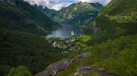 geiranger : Geiranger fjord, Beautiful Nature Norway. It is a 15-kilometer (9.3 mi) long branch off of the Sunnylvsfjorden, which is a branch off of the Storfjorden (Great Fjord). Stock Footage