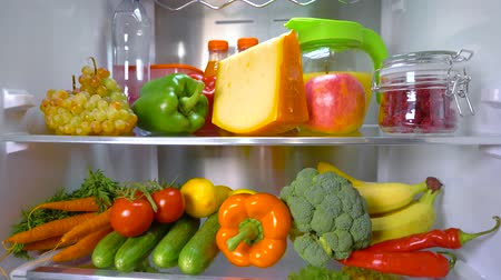 variedade : Open refrigerator filled with food. Healthy food. Stock Footage