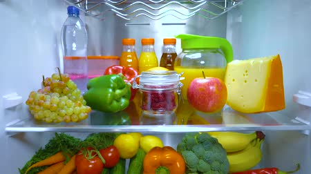 stocked : Open refrigerator filled with food. Healthy food. Stock Footage
