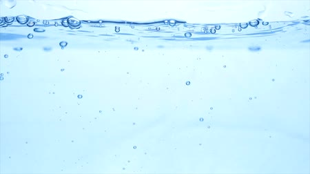 dokonalost : Many bubbles in water close up, abstract water wave with bubbles in slow motion
