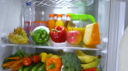peynir : Open refrigerator filled with food. Healthy food. Stok Video