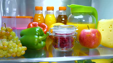 апельсины : Open refrigerator filled with food. Healthy food. Стоковые видеозаписи