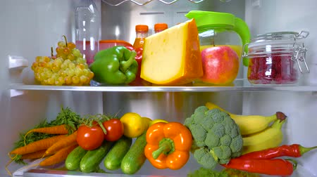 meyve suyu : Open refrigerator filled with food. Healthy food. Stok Video