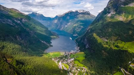 caravan : Geiranger fjord, Beautiful Nature Norway. It is a 15-kilometer (9.3 mi) long branch off of the Sunnylvsfjorden, which is a branch off of the Storfjorden (Great Fjord). Stock Footage