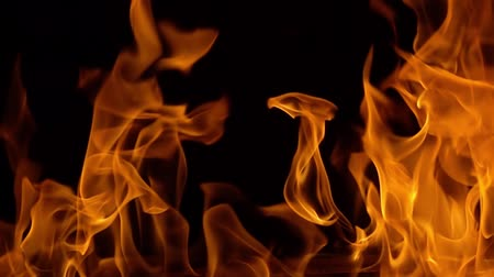extreme close up : Flames of fire on black background in slow motion