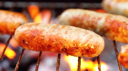 coals : Delicious juicy sausages, cooked on the grill with a fire Stock Footage