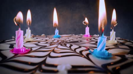 creme : Candles on the birthday cake close-up.
