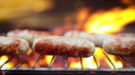 espetos : Delicious juicy sausages, cooked on the grill with a fire Stock Footage