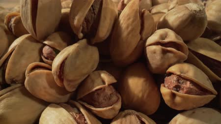 kurak : Close up of pistachios nut. The pistachio a member of the cashew family, is a small tree originating from Central Asia and the Middle East