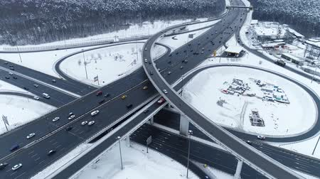 multiple lane : Aerial view of a freeway intersection Snow-covered in winter. Stock Footage
