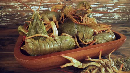 prawns : Live crayfish on a wooden table close-up
