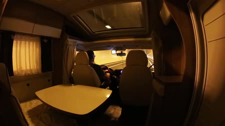 drive through : Man driving on a road through the tunnel in the Camper Van. Caravan car Vacation. Family vacation travel, holiday trip in motorhome
