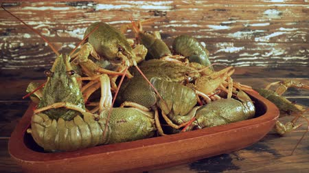 броня : Live crayfish on a wooden table close-up