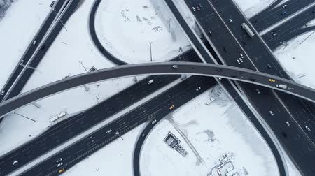 közvetlenül : Aerial view of a freeway intersection Snow-covered in winter. Stock mozgókép
