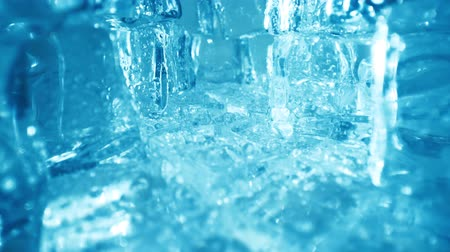 chladič : Ice cubes closeup, abstract background.