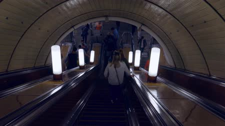 barriers : MOSCOW, RUSSIA - MAY 07, 2019: People riding the escalator in metro station