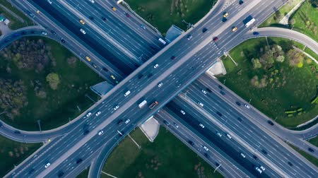 közvetlenül : Timelapse Aerial view of a freeway intersection traffic trails in Moscow.