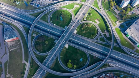 межгосударственный : Timelapse Aerial view of a freeway intersection traffic trails in Moscow.
