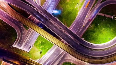 interscambio : Night Timelapse Aerial view of a freeway intersection traffic trails in night Moscow. Loop Timelapse. Filmati Stock