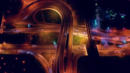 multiple lane : Night Aerial view of a freeway intersection traffic trails in night Moscow